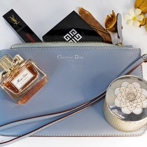 christian dior pebbled real leather zip wristlet